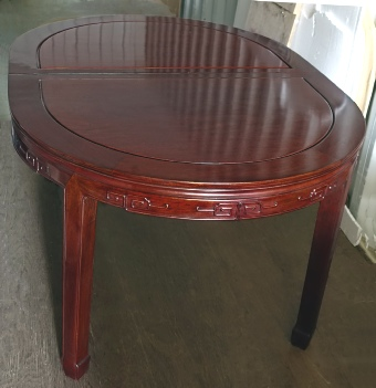Large Chinese Oval table seating 10-14, solid rosewood with carved key design on apron
