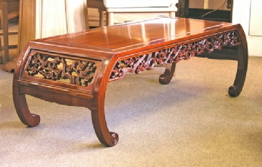 Chinese curved leg coffee table with bird & flower carving & scroll feet.
