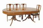 Chinese rosewood dining table - oval 8 seat twin pedestal - carved design.