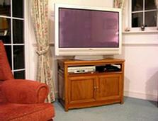 Rosewood TV cabinet with 2 door cupboard.