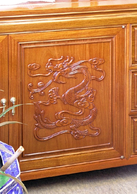 hand carved dragon on chinese rosewood cabinet