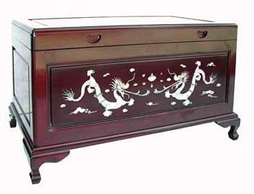 chinese camphorwood chest with dragon inlays.