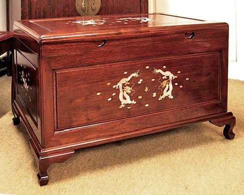Camphorwood lined rosewood chest with mother of pearl inlaid dragons.