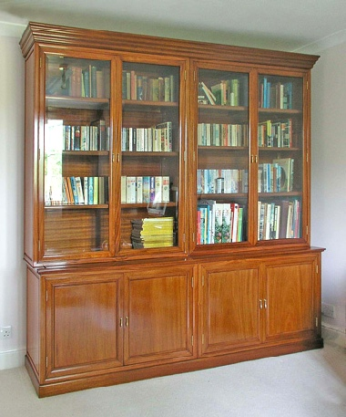 Bespoke book case in solid rosewood, one of a pair.