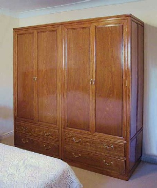 Rosewood double wardrobe with 4 doors and 4 drawers