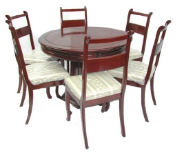 Extendable round dining table with 6 side chairs.