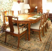 Oval Chinese rosewood dining table and chairs